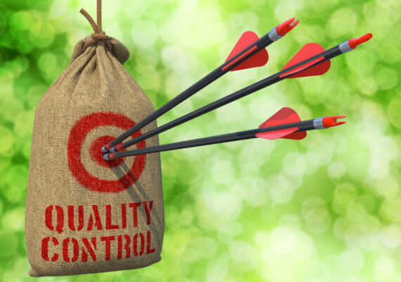 Quality Control - Three Arrows Hit in Red Target on a Hanging Sack on Green Bokeh Background.